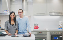 Couple happy with the kitchen equipment
